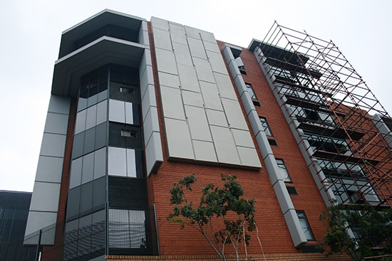 custom made external cladding panels on brick face of the building