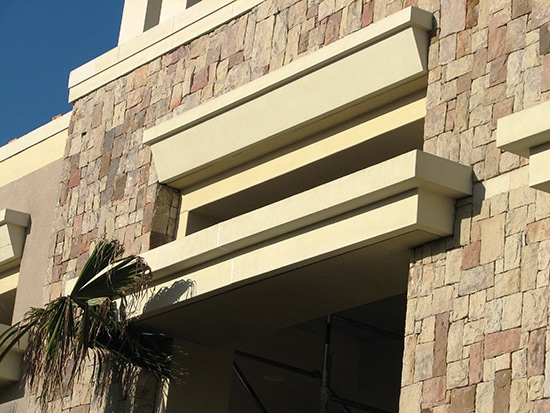 Use of lightweight decolite profiles for external detailing rather than concrete elements